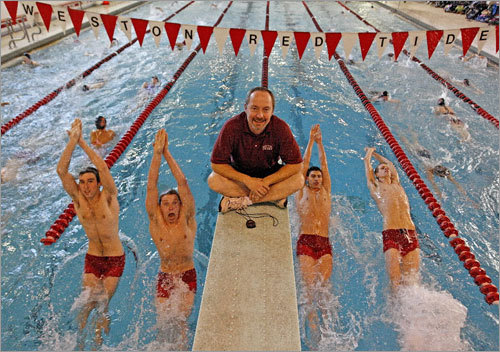 The Weston High swim team captains (left to right) Michael Grant, Chris Rossborough, Claude Valle (head coach), Graham Frankel, and Stuart Butts practiced at Weston Middle School.