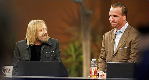 Indianapolis Colts quarterback Peyton Manning (right), sporting a goatee, appeared on the set of the NFL Network at the Phoenix Convention Center. He chatted with rocker Tom Petty, who will be providing the Super Bowl halftime entertainment.