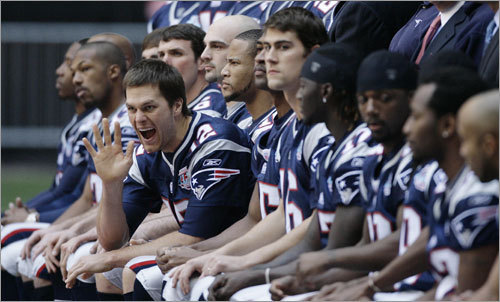 Patriots quarterback Tom Brady waved during the team's picture. The picture was taken at the walk through at University of Phoenix Stadium on Saturday.