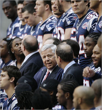 Patriots chairman and owner Robert Kraft, center, is seen as the team gets ready for a team photo.
