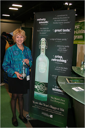 Representative Jacqueline Peiffer models a bottle of 360 Vodka . The quadruple distilled liquor, made in Missouri from local grains, is stored in a bottle made from 85% recycled glass. The beverage's plastic pop-off top can be returned to the company via an envelope attached to the bottle. For every closure received, the company will donate $1.00 to a recognized environmental cause. Last summer, 360 Vodka received nearly 400 tops.