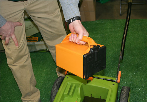 Hughes shows off the lawnmower's electric battery. The Environmental Protection Agency discovered gas-powered mowers can produce 87 pounds of carbon dioxide each season. With Neuton's mower, a household could ideally produce none. Neuton will also offer $110 off any of their mowers if you let them recycle your old gas mower. In Los Angeles, 4,000 people participated in the program last spring.