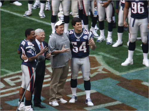 (Left to right) Troy Brown, owner Robert Kraft , coach Bill Belichick and Tedy Bruschi, posed for a photo