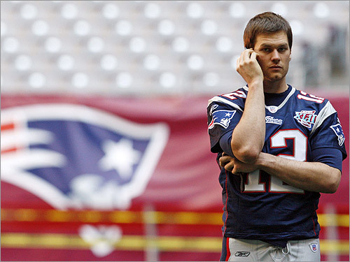 Brady took a break to chat on the phone.