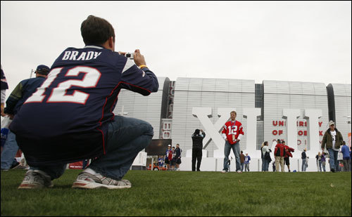 Fans snapped photos outside the stadium as they arrived for Super Bowl XLII.