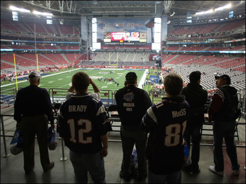 Patriots fans watched the preparations from inside University of Phoenix Stadium, site of the big game.