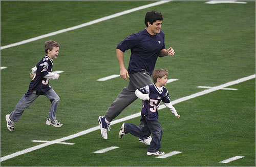 Bruschi began his warmups with his children.