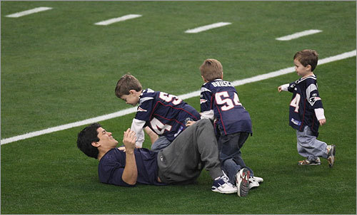 The first tackles on the field in Glendale were made by Bruschi's children.