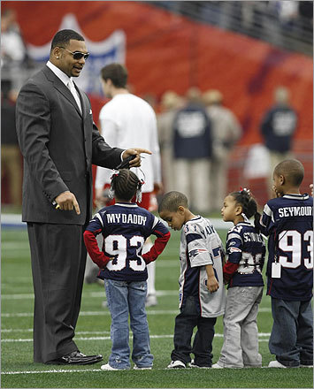 Richard Seymour talked with his children and teammate Rodney Harrison's son.