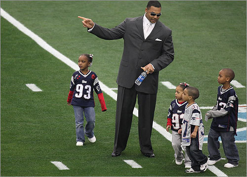 Richard Seymour guided his children and Rodney Harrison's son onto the field.