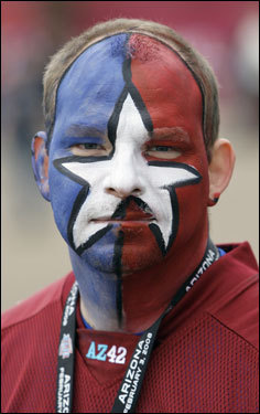 Fan Mike Harper, of Round Rock, Texas, painted his face for the game.