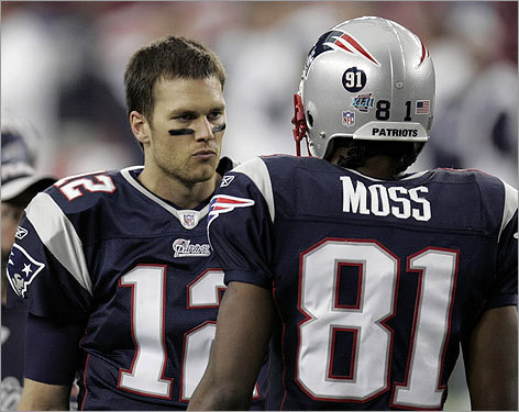 Tom Brady and Randy Moss talked on the field during warmups.