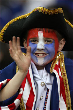 A Patriots fan dressed up for the Super Bowl to support his team.