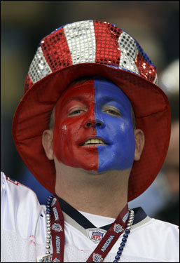 A Patriots fan cheered on his team in the stands at Super Bowl XLII.