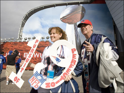 Nadine and Doug Bradshaw, of Raynham, carried their sign outside the stadium before the game.