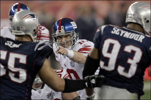 Eli Manning made calls at the line of scrimmage in the first half.