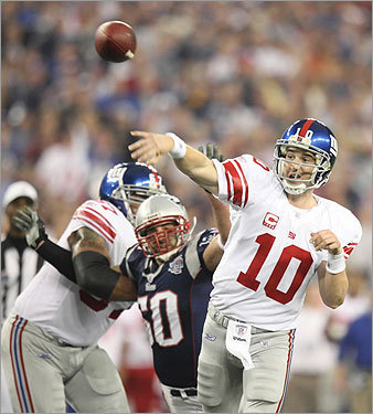 Giants QB Eli Manning fired a pass in the first half.