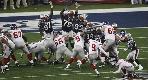The Patriots' defense tried to block Giants kicker Lawrence Tynes's field goal in the first quarter.