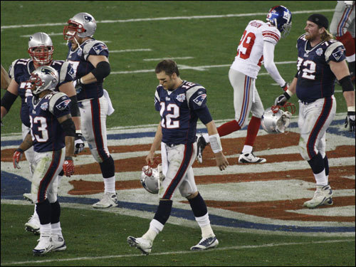 Tom Brady (12) and the Patriots offense walked off the field near the end of the first half.