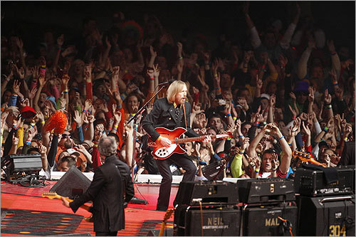 Fans on the field cheered for the halftime entertainment, Tom Petty and the Heartbreakers.