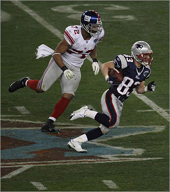 Wes Welker (83) rushed past Osi Umenyiora (72) in the third quarter.