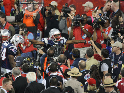 Randy Moss celebrated with fans after catching the go-ahead touchdown in the fourth quarter.