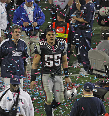 Junior Seau watched as the Giants celebrated their victory.