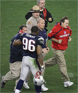 Patriots head coach Bill Belichick jogged onto the field to congratulate Giants head coach Tom Coughlin.