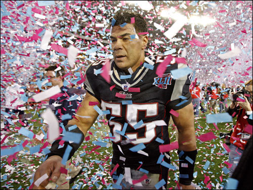 Patriots linebacker Junior Seau walked off the field disappointed after the Patriots' loss.