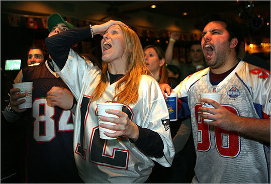 Katie Powell and Mike Berrini were among the hundreds of Patriots fans watching at Stadium Sports Bar & Grill.