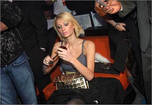 Paris Hilton put on make-up after arriving at her 6th Anniversary 944 Magazine party at 944 Super Villa in Scottsdale, Ariz., on Jan. 31, 2008.