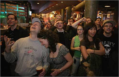 Rita Kozma (second from left) and T.J. Kozma (far left) at the Boston Beer Works on Feb. 3 reacted to the New England Patriots during the fourth quarter of the game.