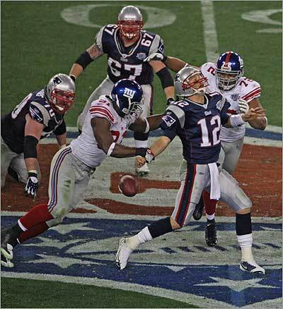 Giants Justin Tuck grabbed Patriots Tom Brady, which caused a fumble in the second quarter of the Super Bowl. New England Patriots played against the New York Giants in Super Bowl XLII on Feb. 3 in the University of Phoenix Stadium.