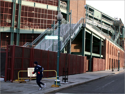 A lone jogger turns the corner onto Yawkey Way prior to the truck's arrival.
