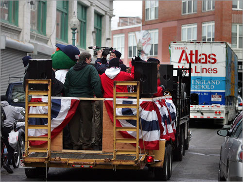 In addition to the equipment truck, a flatbed truck with Red Sox employees, as well as the team's mascot, helped with the send off.