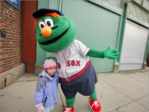 Wally, the Red Sox mascot, greeted 4-year-old Kaia Outzan, one of about 50 fans that saw the truck off.