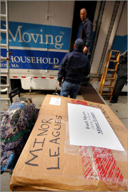 A box labeled 'Minor Leagues' waited to be loaded onto the truck.