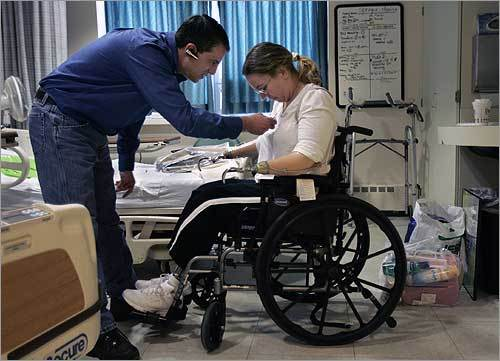 Tony Jorge with Monica on the morning of Dec. 15, when she was leaving the hospital. 'Loss of limbs or loss of life – it's no choice,' he says.