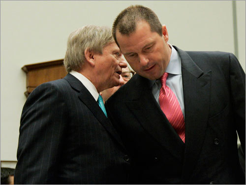 Former New York Yankees pitcher Roger Clemens (right) listens to his attorney Rusty Hardin (left) on Capitol Hill in Washington.