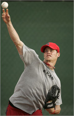 Clay Buchholz delivers a throw while working out in the bullpen Wednesday.
