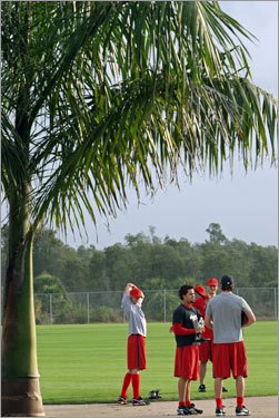 Red Sox pitchers (from left) Clay Buchholz, Manny Delcarmen, Javier Lopez, and Craig Hansen get loose before working out.