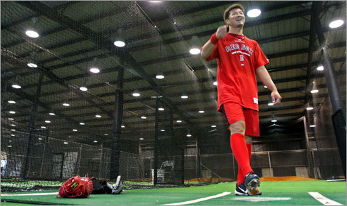Hideki Okajima was in camp Wednesday, and the rains forced him to do his work inside the dark indoor batting cage area.