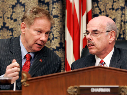 House Oversight and Government Reform Committee chairman Representative Henry Waxman (right), Democrat of California, talks with the committee's ranking Republican, Representative Tom Davis III if Virginia.