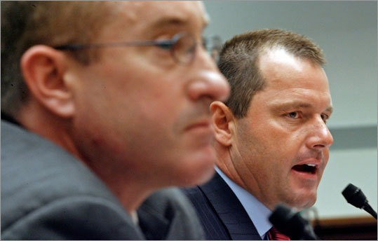 Major League Baseball pitcher Roger Clemens (right) and former Major League Baseball strength and conditioning coach Brian McNamee testify about allegations of steroid use by professional ball players before the U.S. House Oversight and Government Reform Committee on Capitol Hill February 13, 2008 in Washington, DC.