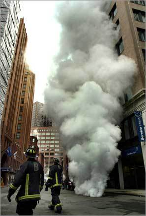 Bursts of steam filled the air around Batterymarch Street on Feb. 9, forcing the closure of the street for hours after a water pipe broke and the leaking water came into contact with steam lines, authorities said.