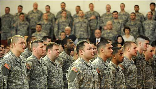 Soldiers stood at attention during an official welcome home ceremony held for members of the 182d Cavalry Massachusetts National Guard unit in Melrose on Feb. 10. The unit was deployed to Kosovo and returned to Massachusetts on Nov. 1, 2007.