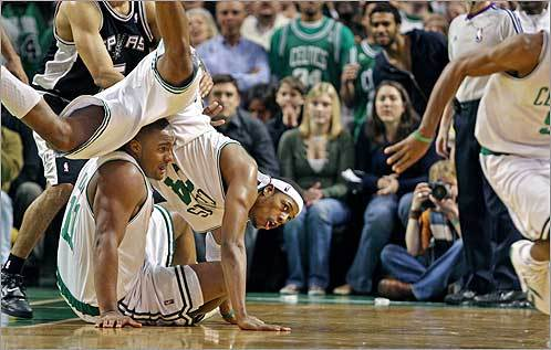 The Celtics beat the Spurs on Sunday, Feb. 10. The stars of the game for Boston, Paul Pierce and Glen Davis, collided as they and teammate Rajon Rondo (far right) scrambled for a loose ball with less than 25 seconds left in the game.