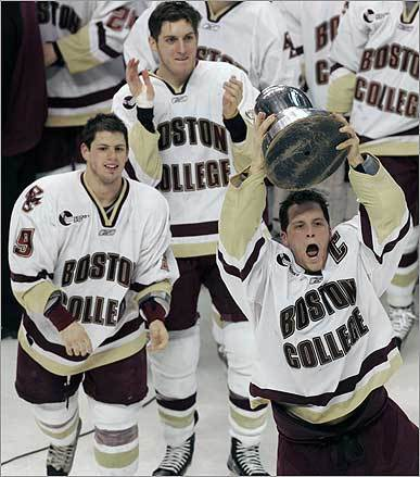 Boston College played Harvard University in the Beanpot Monday, Feb. 11, at the TD Banknorth Garden. BC captain Mike Brennan showed off the Beanpot trophy after winning in overtime.