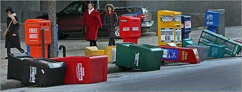 Gusts of wind as powerful as 50 miles per hour knocked over news boxes on Staniford Street in Boston on Monday, Feb. 11.