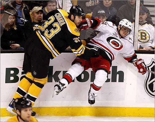 Boston Bruins' Zdeno Chara checked Jeff Hamilton of the Carolina Hurricanes in the first period of their game on Tuesday, Feb. 12.